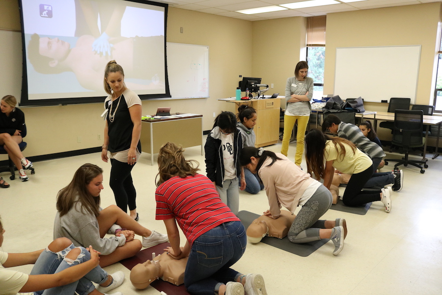 Students receiving CPR training
