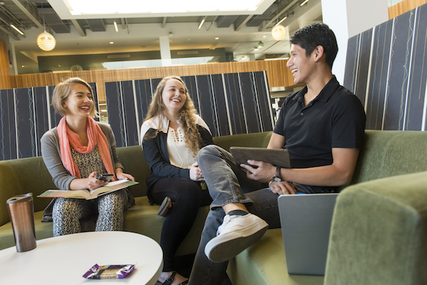 three-students-library-similing.jpg